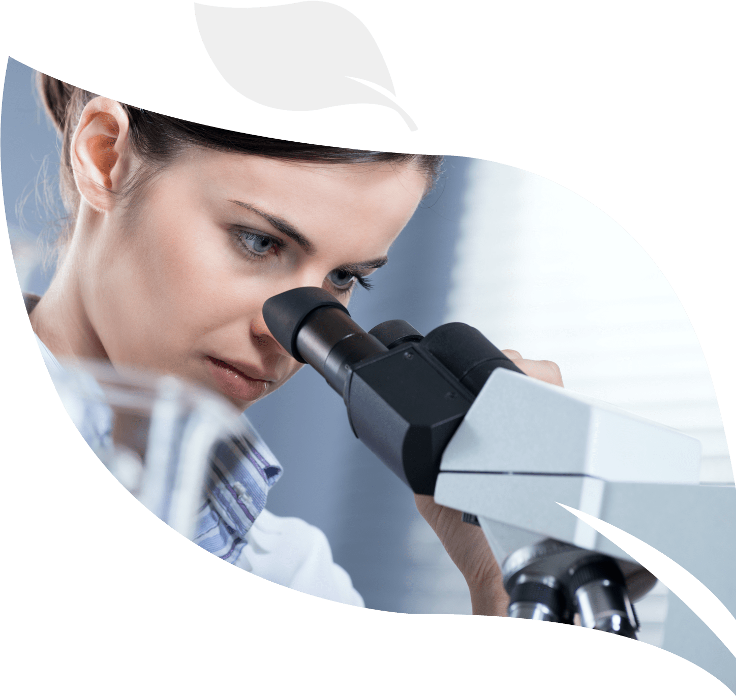 a person working in biotechnology using a microscope in a laboratory environment